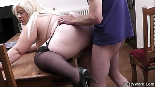 Busty blond secretary pleases her boss