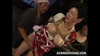 Bound japanese milf moans during the time that her fur pie is teased
