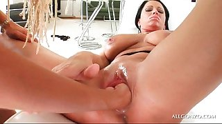Big titted lesbian sex bomb acquires fur pie filled with a unfathomable fist