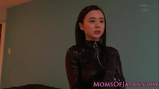 Costumed oriental mamma in catsuit facialized